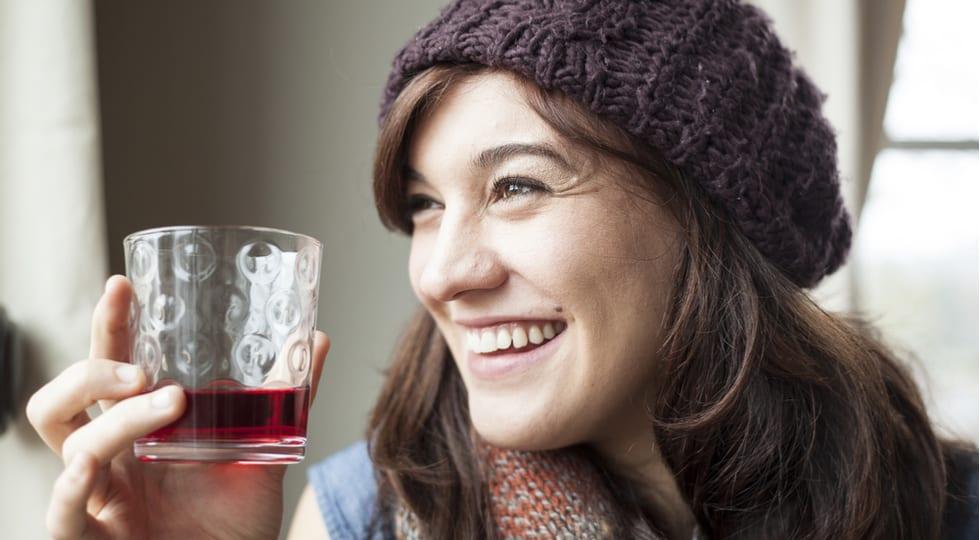 avoiding UTIs - woman with cranberry juice